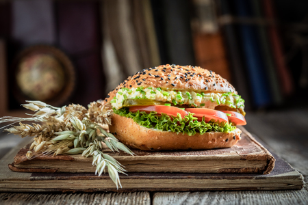 Delicious sandwich with tomato, lettuce, egg paste