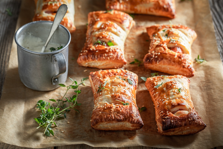 Fresh sausage roll with thyme and sesame seeds