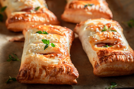 Tasty sausage in puff pastry as a snack for breakfast Stock Photo