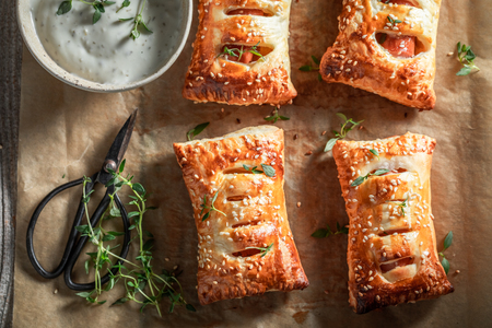 Homemade sausage roll with thyme and sesame seeds Stock Photo
