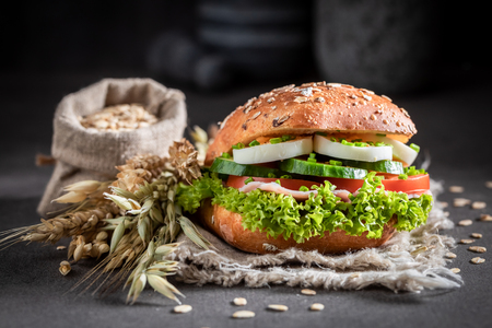 Tasty sandwich with lettuce, egg and tomato Banco de Imagens