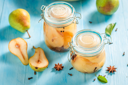 Top view of sweet and tasty pickled pears Banco de Imagens - 121644317