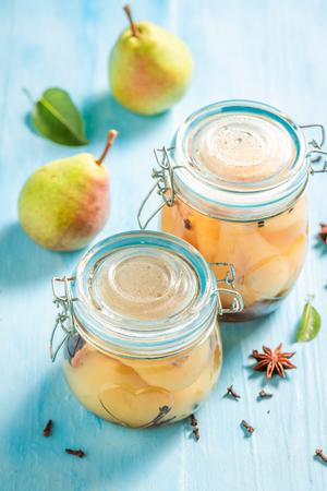 Closeup of fresh pickled pears in the jar Banco de Imagens - 121644227