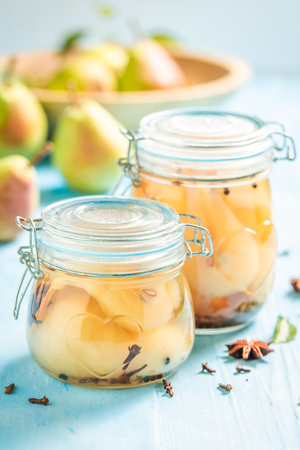 Ingredients for fresh pickled sweet pears on blue table Banco de Imagens - 121644249
