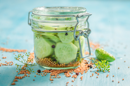 Healthy and homemade pickled cucumber on blue table Stock Photo