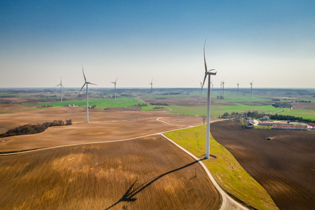 Flying above big wind turbines as pure energy Imagens