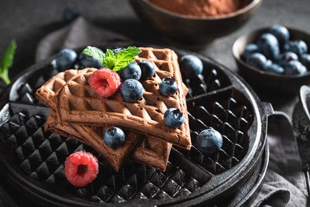 Fresh waffles with dark chocolate and fresh blueberries