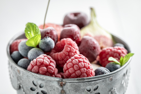 Delicious ice cream sorbet with berry fruits and mint leaf