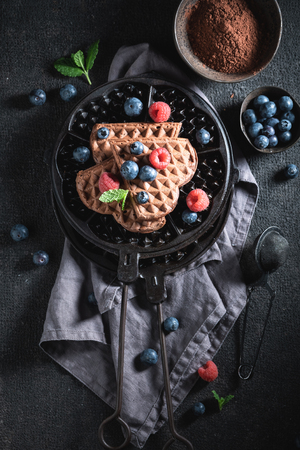 Top view of waffles made of cocoa with berry fruits 写真素材