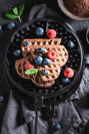 Top view of waffles with dark chocolate and fresh blueberries 写真素材