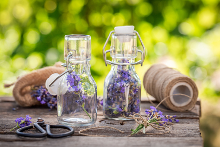 Summer harvest of lavender in small bottles