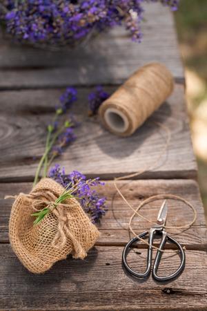 Freshly harvested lavender on wooden table in summer Banco de Imagens