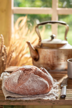 Loaf of bread in rustic kitchen with fresh coffee Stock Photo