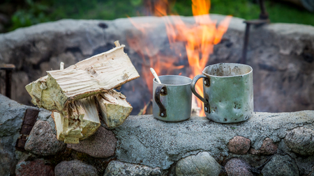 Hot and fresh hot coffee with kettle on bonfire