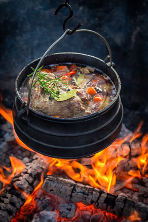 Delicious and fresh hunters stew with vegetables on bonfire Zdjęcie Seryjne