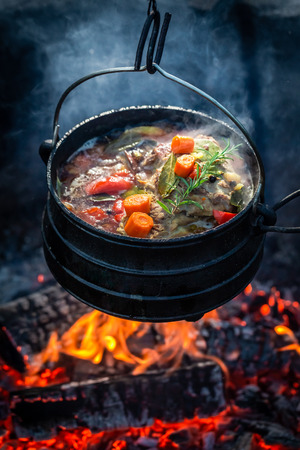 Closeup of fresh hunters stew on campfire