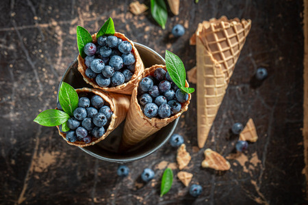 Sweet and fresh blueberries in waffels as ice cream concept