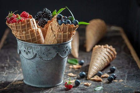 Sweet and fresh berry fruits in waffels as concept 스톡 콘텐츠