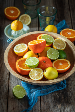 Healthy and fresh mix of citrus fruits on rustic table
