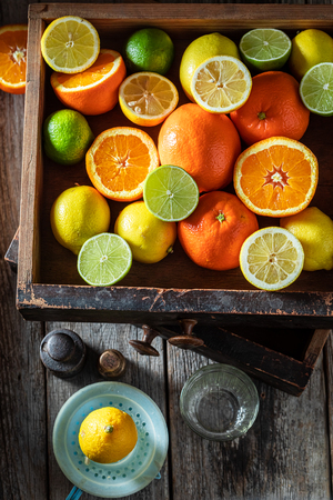 Fresh mix of citrus fruits on wooden table