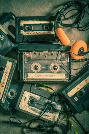 Top view of old audio cassette with headphones