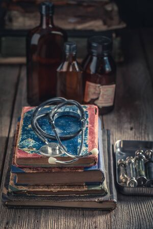 Antique stethoscope and books as medical education concept