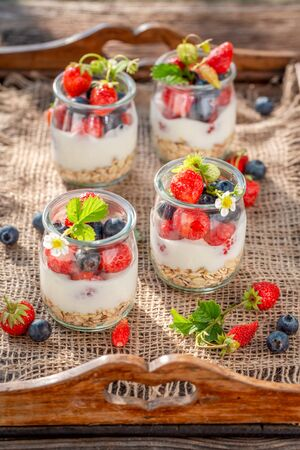 Closeup of granola with berries and yoghurt in jar