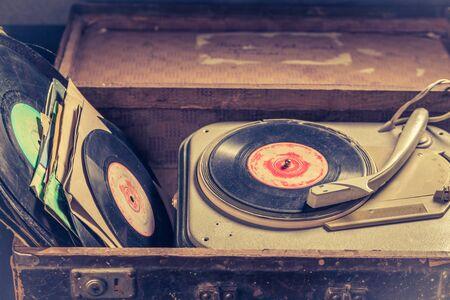 Closeup of retro gramophone with few black vinyl records Stok Fotoğraf