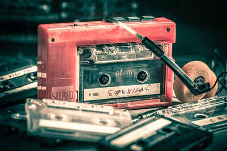Classic cassette tape with red player and headphones