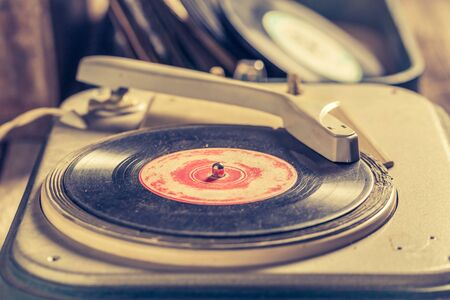 Retro record player with few black vinyl records
