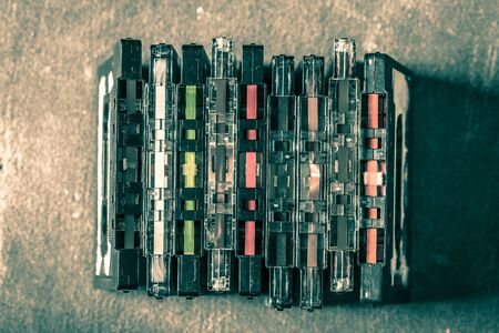 Old pile of cassette tape on gre table