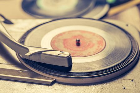 Retro gramophone and old scratched vinyl records