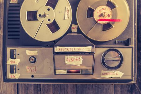 Retro audio reel recorder with roll of tape and microphone