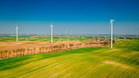 Wind turbines on green field, Poland from above
