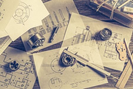 Top view of designer desk of mechanical parts Фото со стока