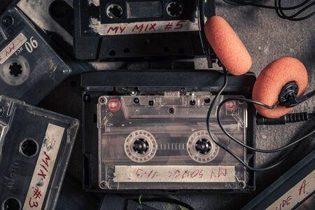 Vintage audio cassette with headphones Imagens