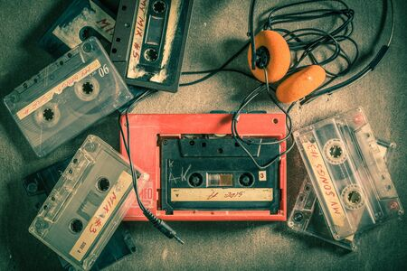 Retro audio cassette with headphones and portable music player