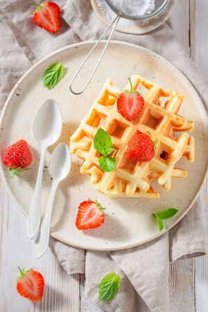 Tasty wafers with sweet strawberries and mint