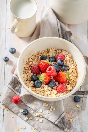 Tasty oat flakes with fresh fruits as healthy meal 스톡 콘텐츠