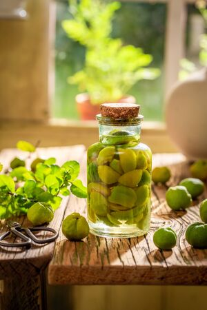 Tasty quince tincture made of fresh fruits and alcohol Stock Photo