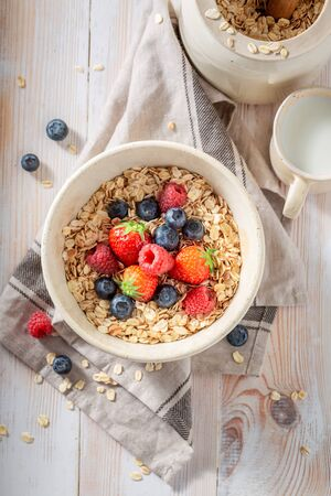 Delicious oat flakes with berry fruits as healthy meal