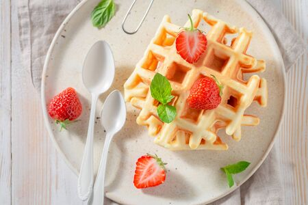 Delicious wafers with sweet strawberries and mint