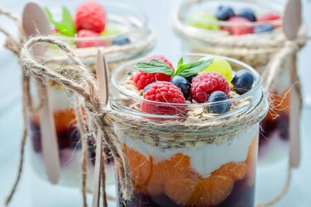 Closeup of granola in jar with yoghurt and berry fruits Stock Photo