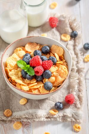 Delicious cornflakes with berries and milk as healthy meal