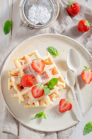 Homemade wafers with sweet strawberries and mint