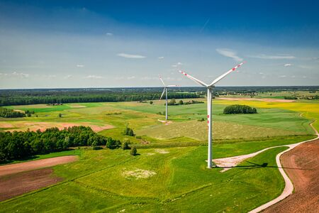 Wind turbines on green field, aerial view of Poland