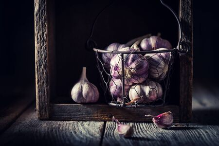 Homegrown garlic in old rustic wooden box