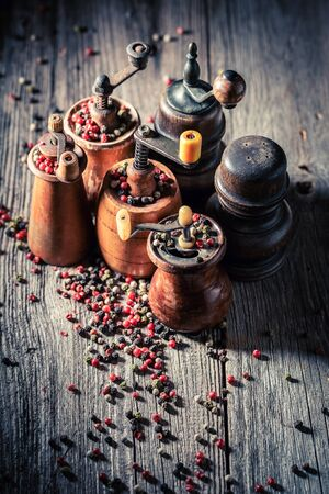 Top view of pepper mills with black and red pepper