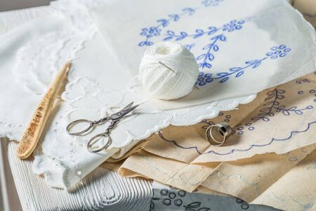 Closeup of embroidered napkins with white thread Archivio Fotografico - 128701493