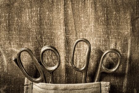 Handmade background with scissors in vintage tailor workshop Stock Photo